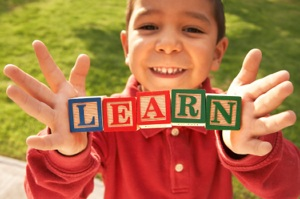 child-with-learn-letter-blocks