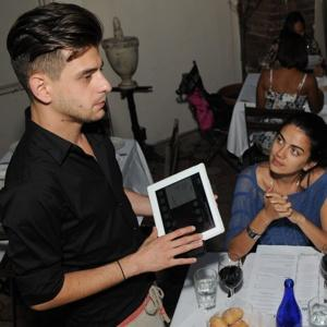 waiter serving from ipad