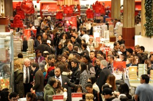People crowd the aisles inside Macy's de